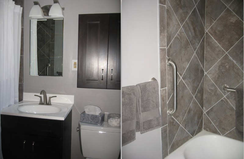 ... Tiles On The Floor And Tub Surround, With Gray Walls And Towels, And  Dark Shaker Style Cabinets (Martha Stewart Brand). Plus Mistos Plumbing  Fixtures, ...